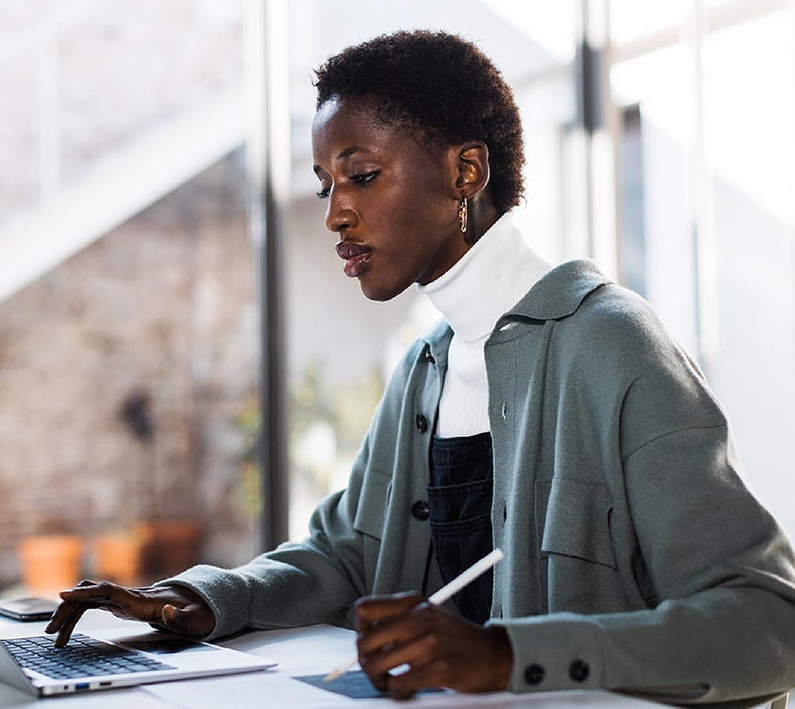 Photo of a woman working with laptop